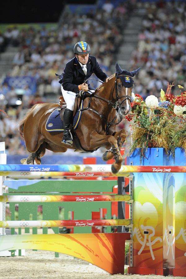 Rolf-Göran Bengtsson red inn til en sølvmedalje i OL med KWPN-hesten Ninja La Silla etter Guidam, som er representert i finalen. (Foto: Kit Houghton/FEI)